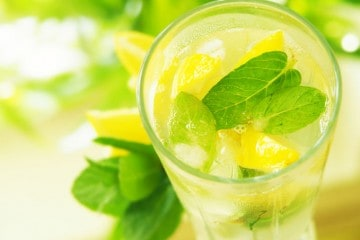 glass of lemon water with mint
