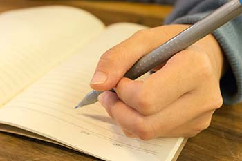 hand writing in journal