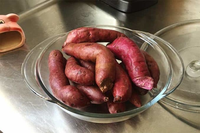 casserole dish of raw purple yams