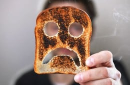 burnt toast with frown face