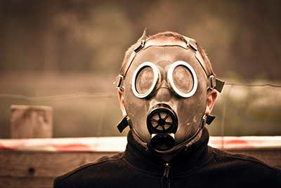 boy wearing gas mask