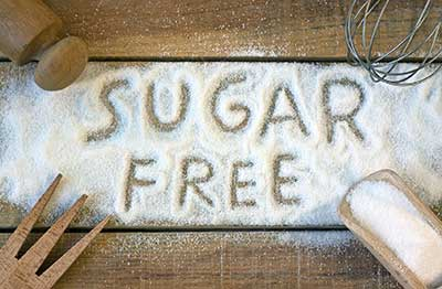 "words ""sugar free"" written in sugar"