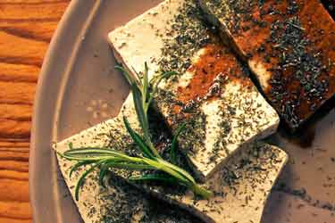 tofu on plate with spices and soy sauce