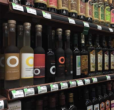 different vinegar types on Whole Foods shelf
