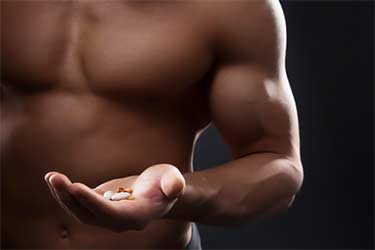athlete holding supplements
