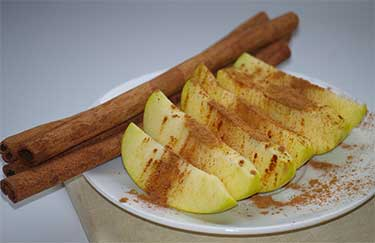 cinnamon on sliced apples