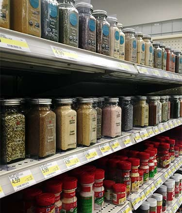 dried spice bottles at grocery store