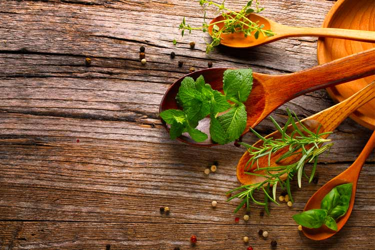 fresh herbs on spoons