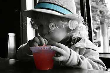 toddler girl drinking watermelon juice