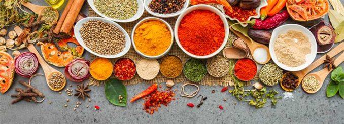 dozens of different ground spices and herbs
