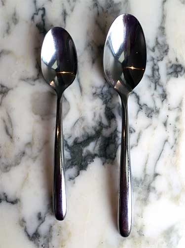 teaspoon next to tablespoon