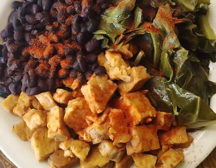 plate of tempeh, black beans, collard greens