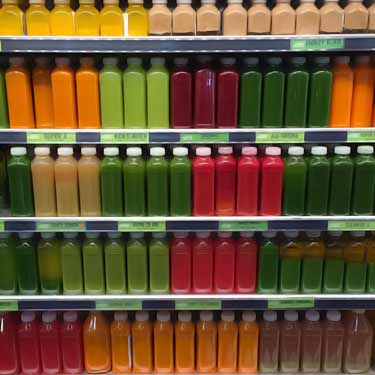 bottles of different colored raw juices