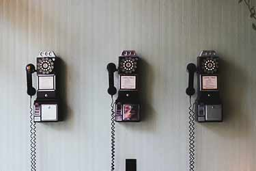 antique rotary telephones on wall
