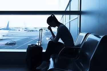 stressed woman at airport