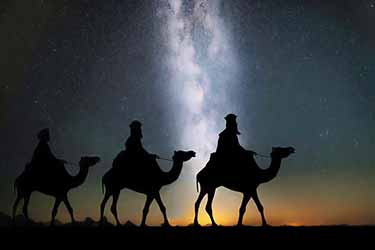 Biblical magi on camels during starry night