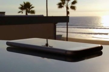 iPhone on desk in front of ocean sunset