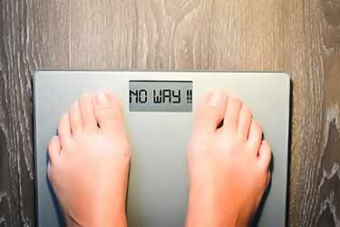 "body scale that says ""no way"" to weight"