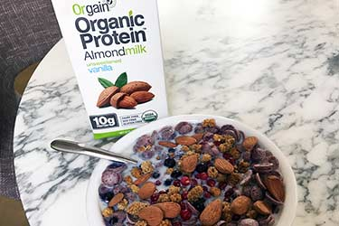 plant based alternative Orgain milk in bowl of cereal