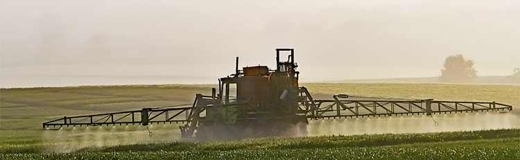 roundup spraying on field by tractor