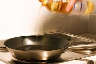 pouring cooking oil into frying pan