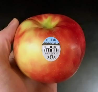 apple with sticker PLU 3283 for conventional Honeycrisp