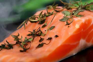 smoked salmon with fresh herbs on top