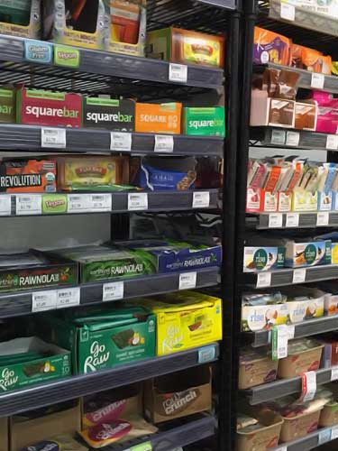 protein and energy bars for sale at natural grocery store