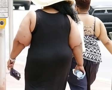 fat women walking on sidewalk