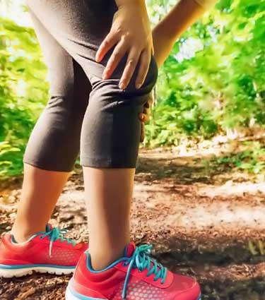 female runner with knee pain