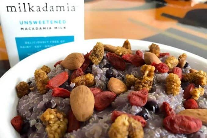 quinoa porridge with mulberries, blueberries, goji, and almonds
