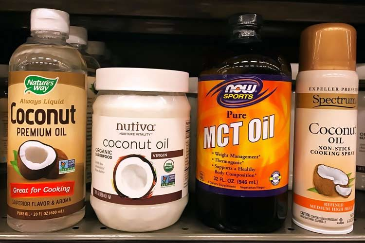 fractionated vs. coconut oil brands side by side on store shelf