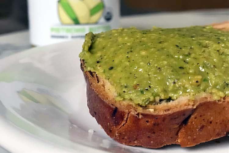 organic pistachio spread on a piece of toast