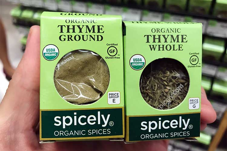 Spicely Organics brand ground and whole thyme spice packages