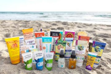 containers of organic and mineral based sunscreens on beach