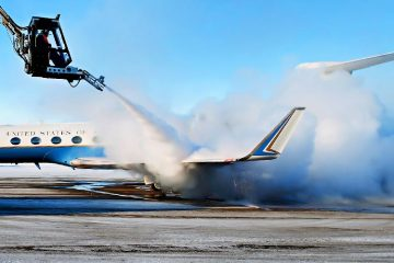 plane being de-iced with propylene glycol spray