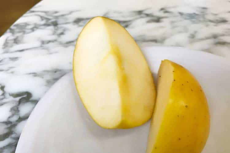 slices of yellow-skinned apples on plate