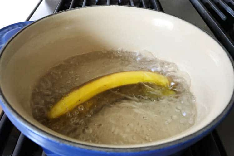 banana boiling in water on stove