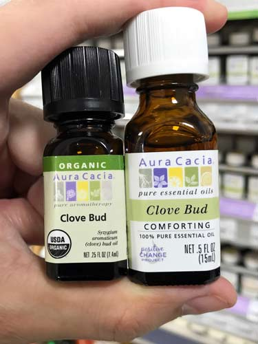 conventional vs. organic clove bud oil next to each other
