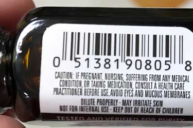 warning label on patchouli oil bottle