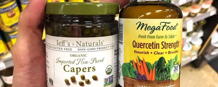 holding organic capers jar and quercetin supplement