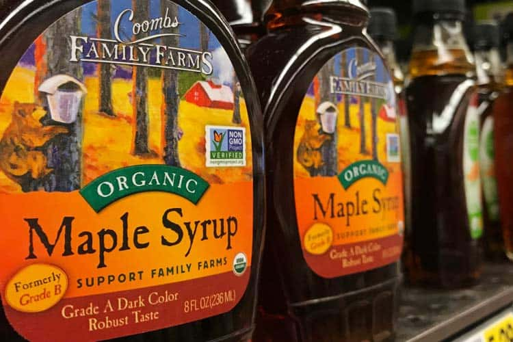 Grade A dark organic maple syrup bottles on store shelf