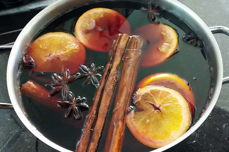 making mulled wine in pot on stove