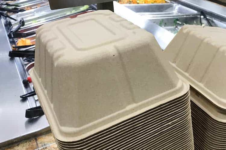 stack of natural unbleached molded fiber food containers