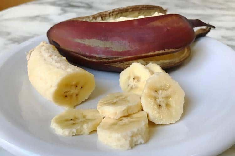 sliced red banana with peel on plate