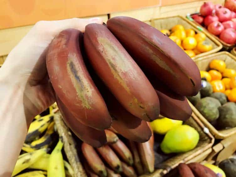 hand of red bananas for sale at Whole Foods in Los Angeles