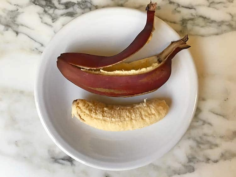 whole red banana with peel