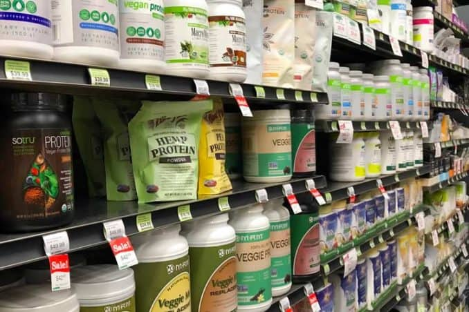 protein powders aisle at store