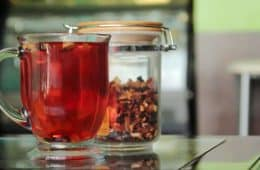 cup of herbal tea high in red anthocyanin antioxidants