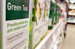 box of green tea antioxidant supplements on shelf